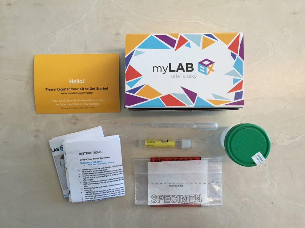 myLAB Box kit components which includes instructions, swab, urine sample vial, and pre-postmarked packaging