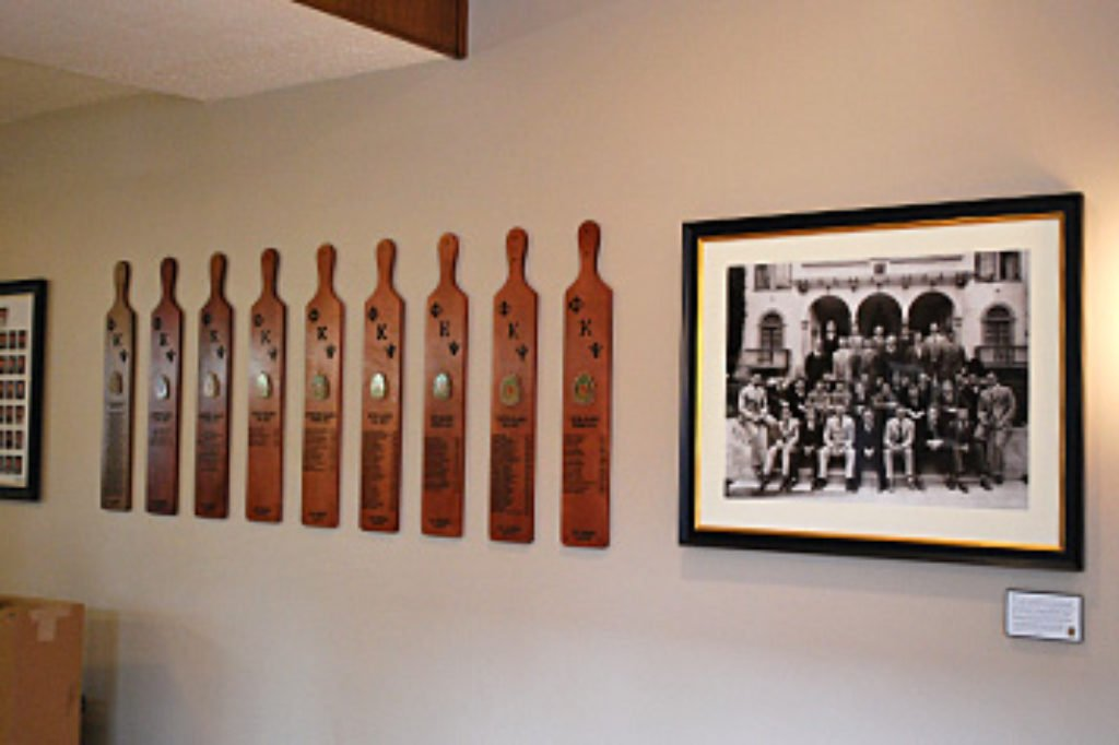 Fraternity paddles hung on the wall