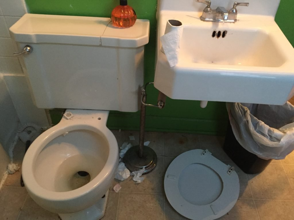 Dirty disgusting toilet, with a broken seat