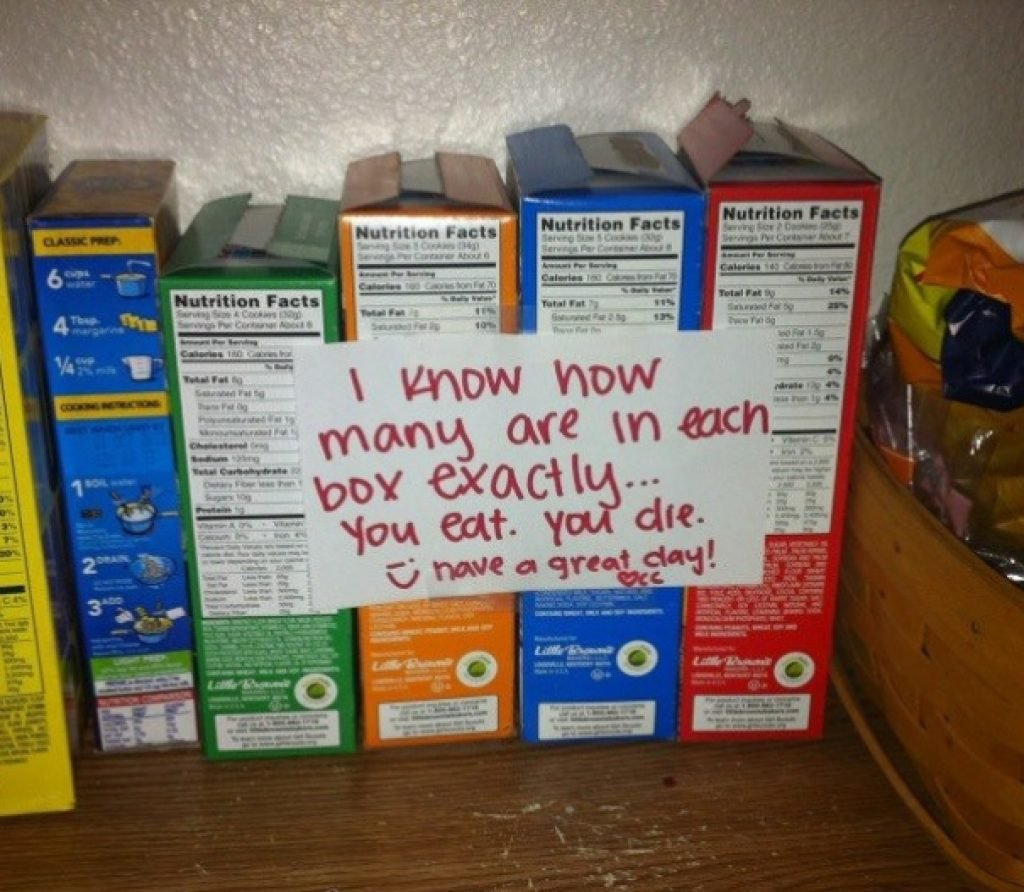 A row of snacks with a threatening note about eating them