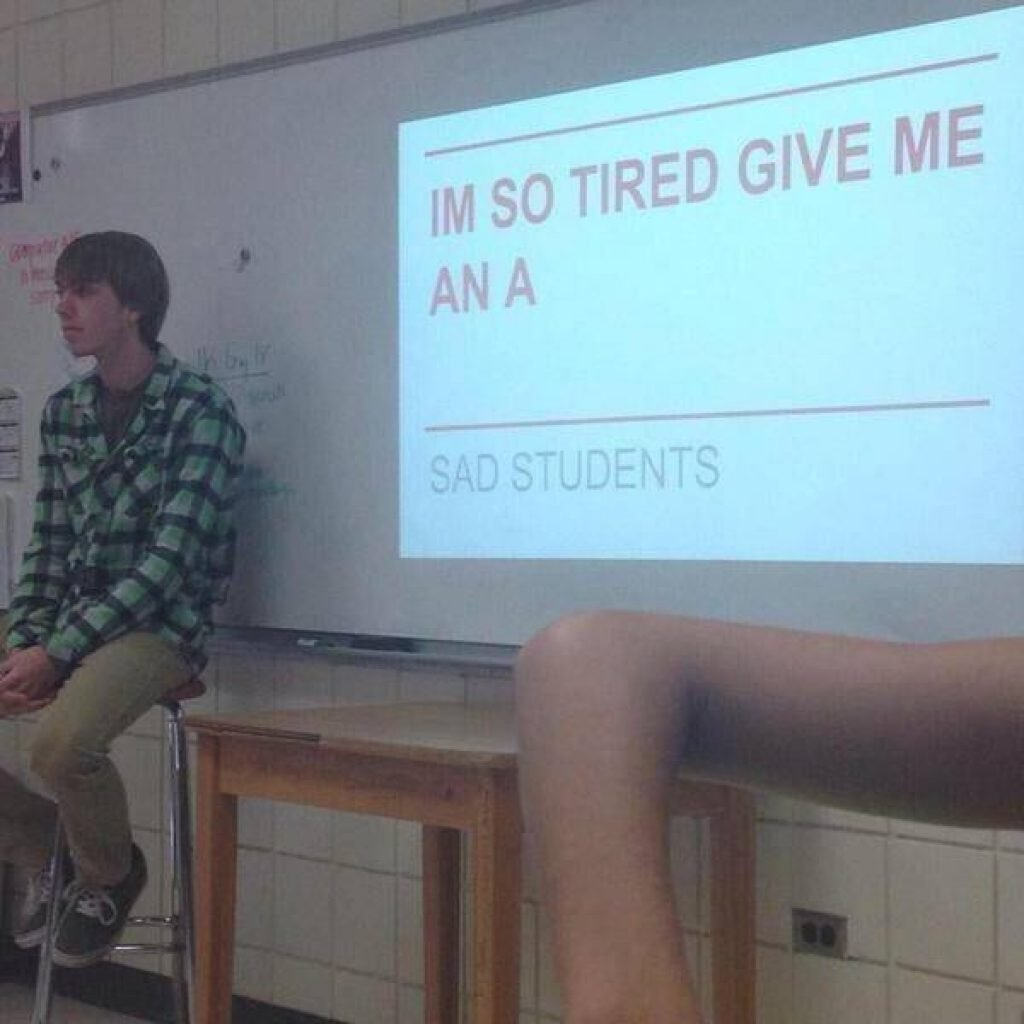 A student sits in defeat in his group project