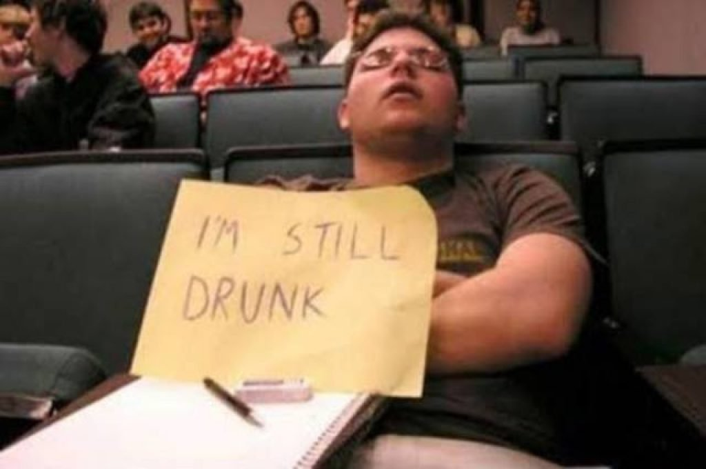"""A guy passed out in lecture with a sign saying """"I'm Still Drunk"""""""