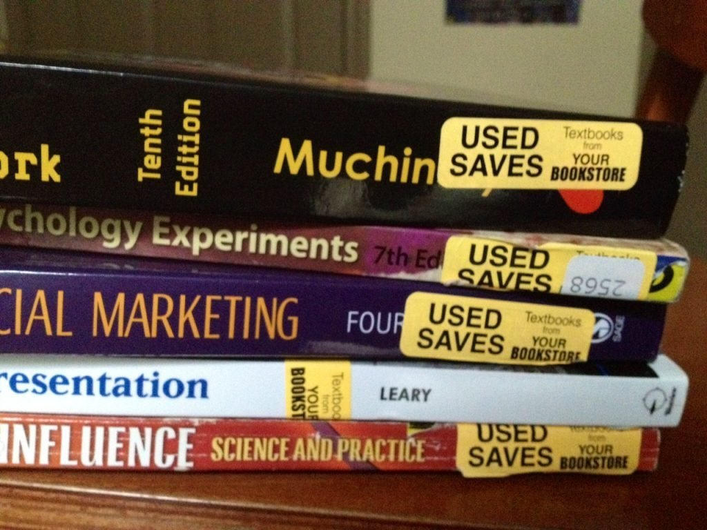 A pile of used textbooks for rent
