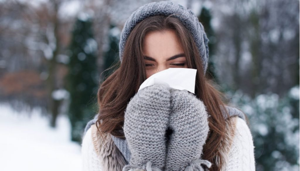 Girl blowing her nose in the snow
