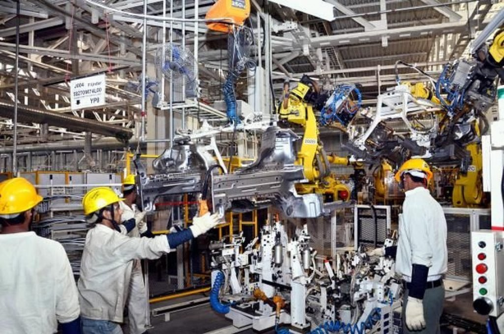 Mechanical engineers working at a plant
