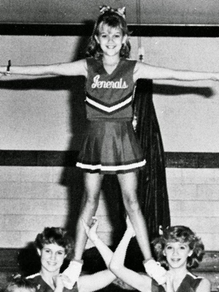 Reese Witherspoon as the top of the cheer pyramid