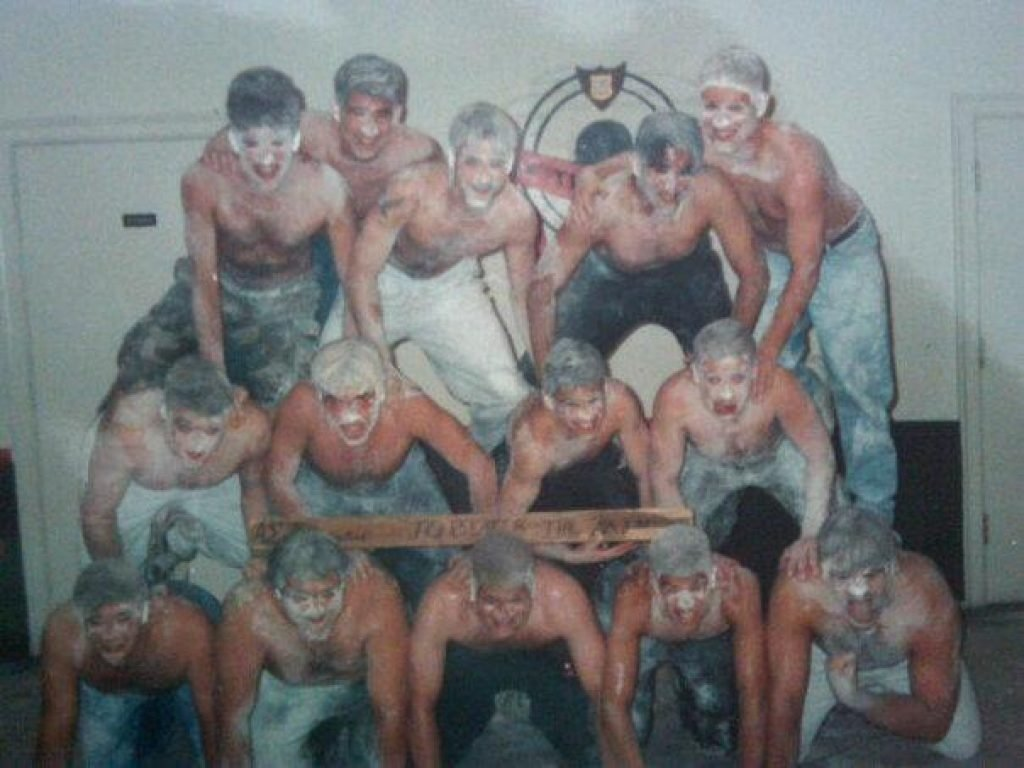 Frat boys in a pyramid covered in baby powder