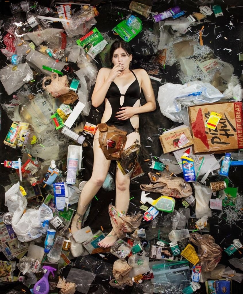 Girl surrounded by garbage