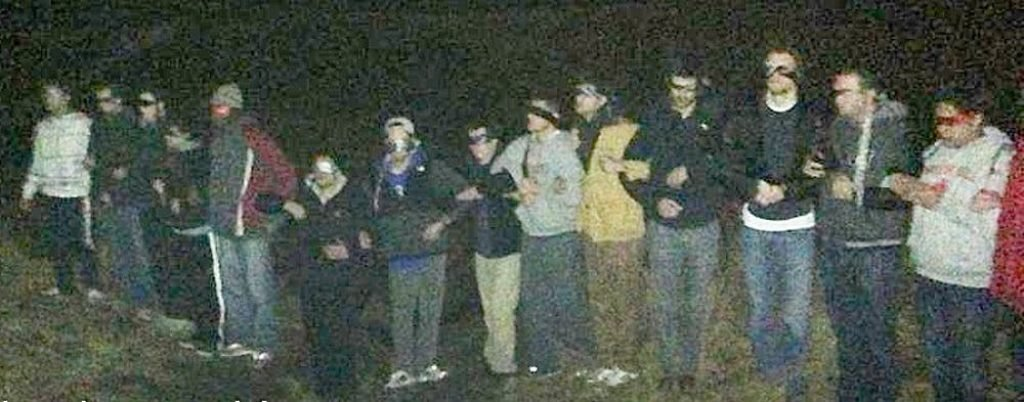 Frat brothers blindfolded in the woods