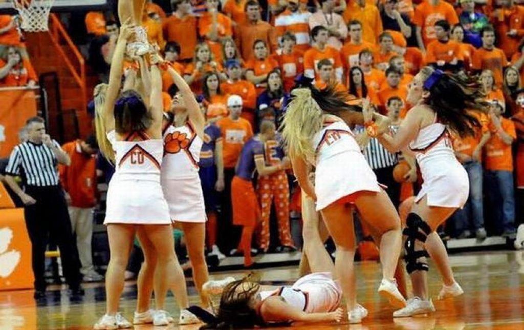Cheerleader falling on basketball court