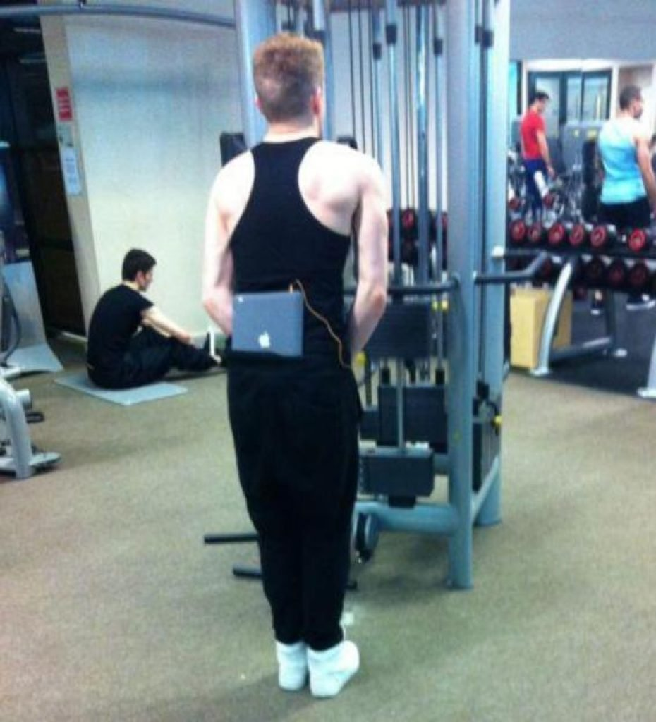 Guy with his laptop tucked into his pants while working out