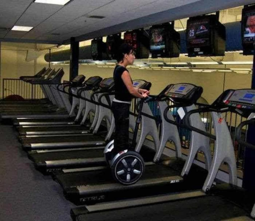 Girl and her segway on a treadmill