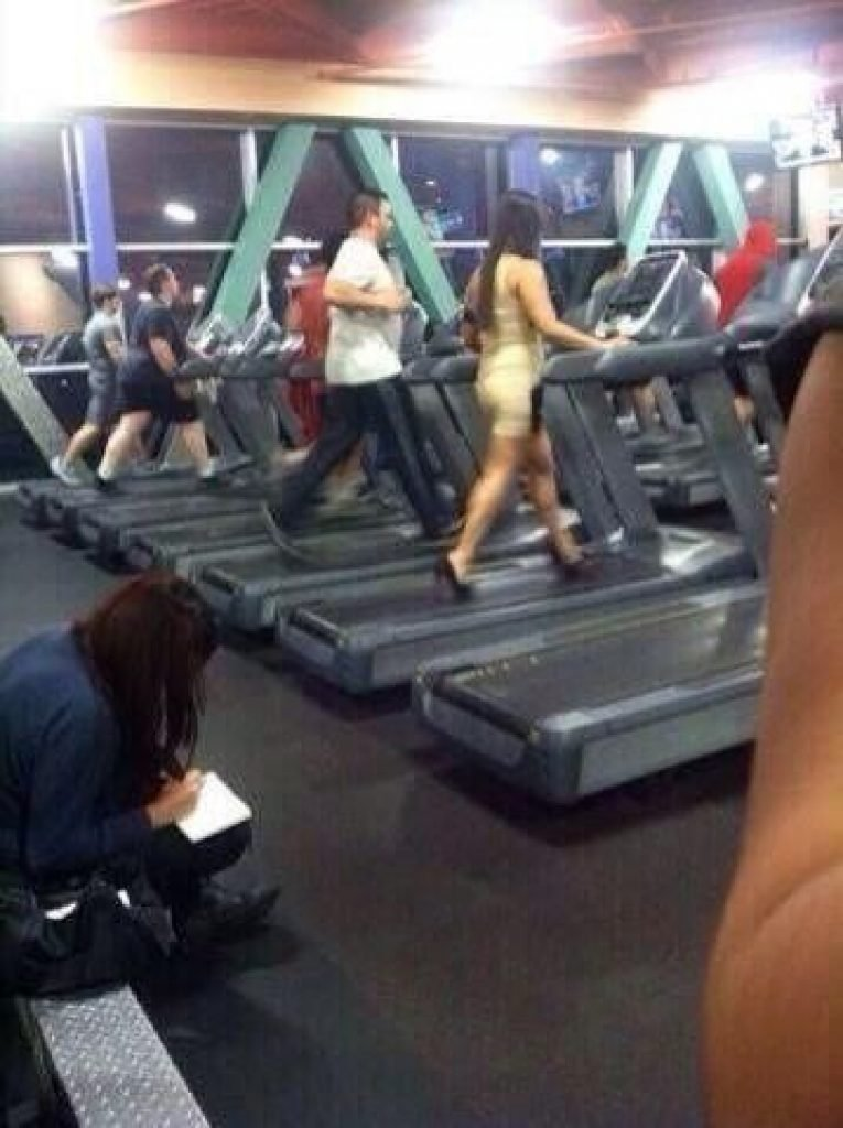 Girl on the treadmill in a dress and heels