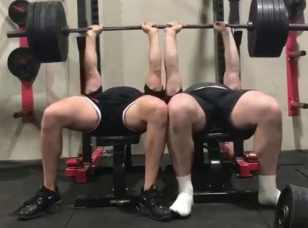 Two guys benching the same weight