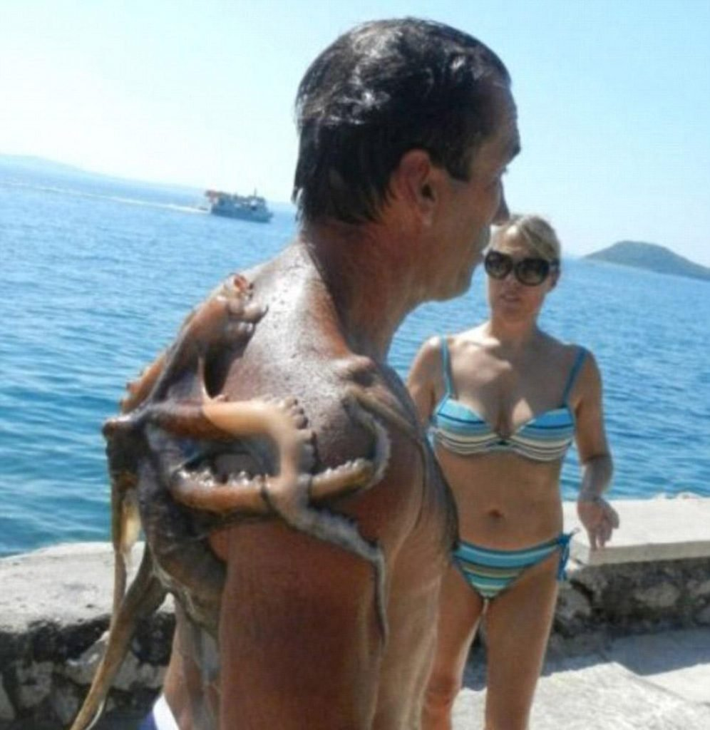 Guy with an octopus stuck to his back
