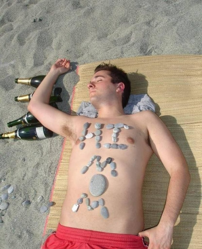Guy passed out with rocks on his belly spelling out hi mom