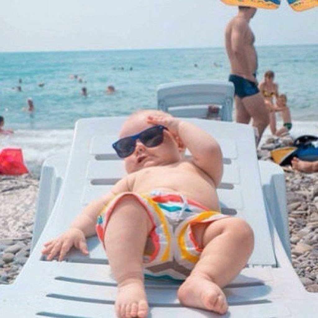 Baby lounging in the sun at the beach