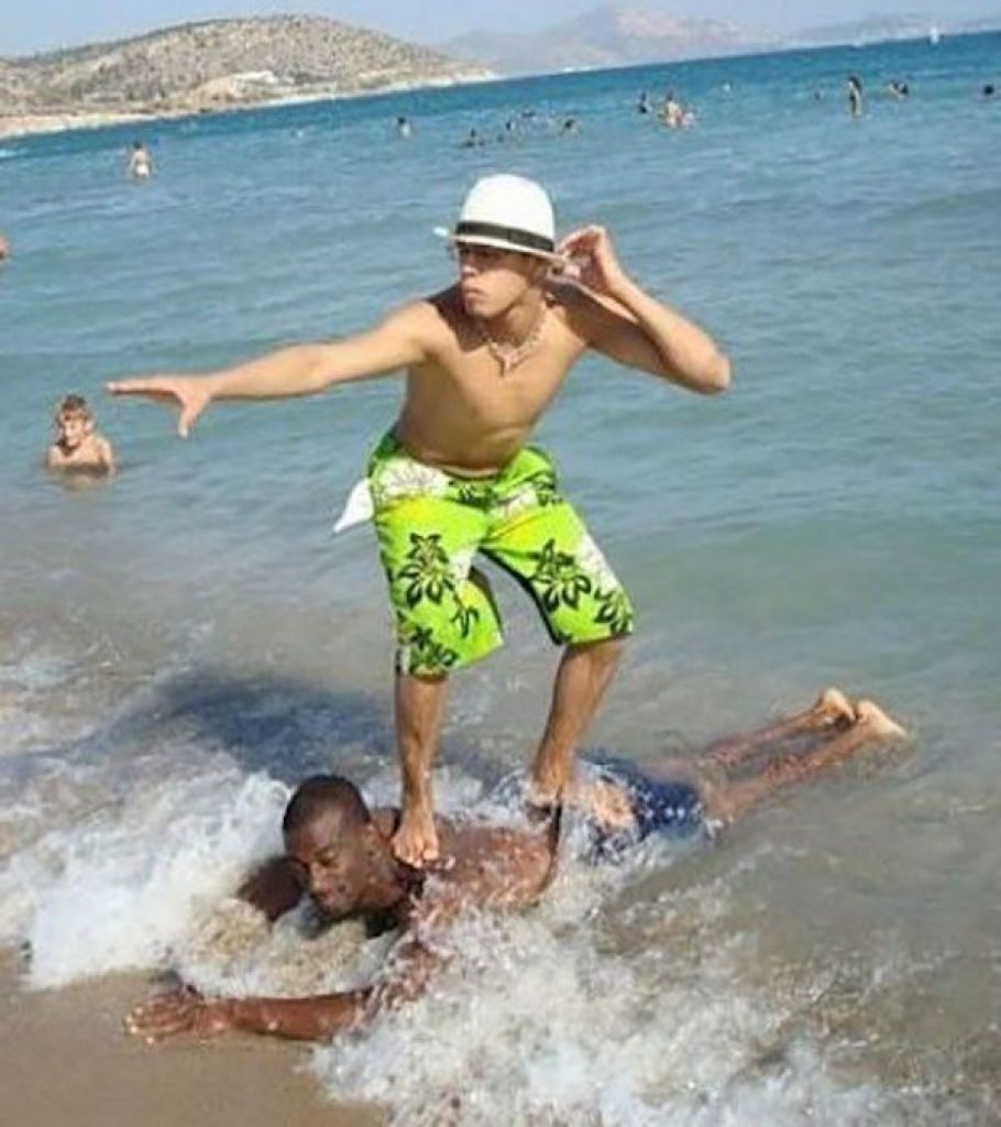 Guy body surfing on his friend