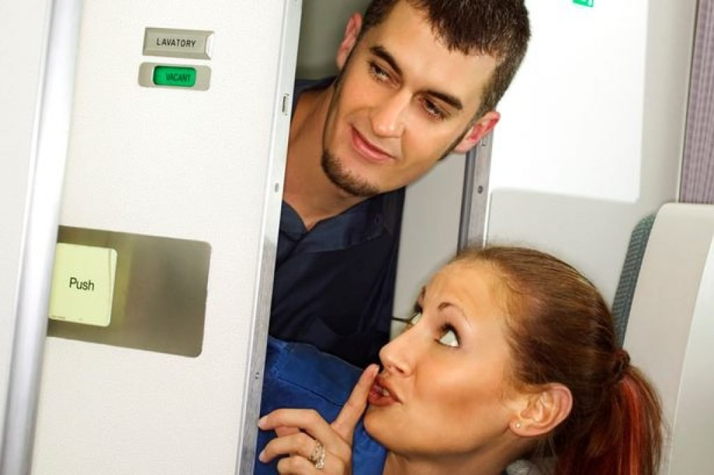 Couple sneaking out of plane lavatoryP