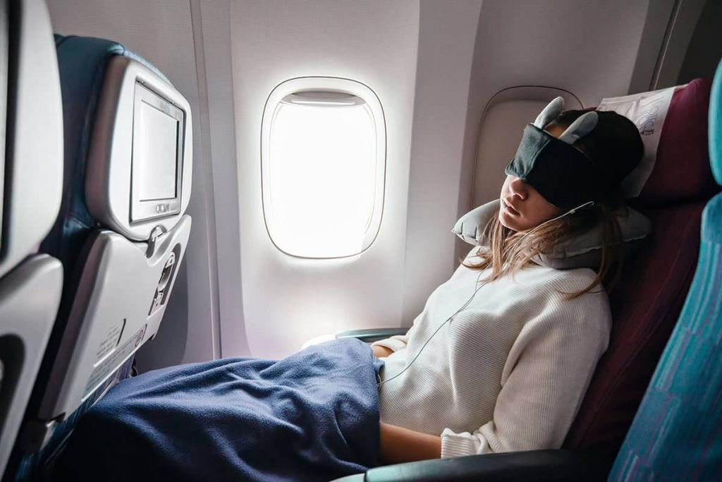 girl with blanket on a plane