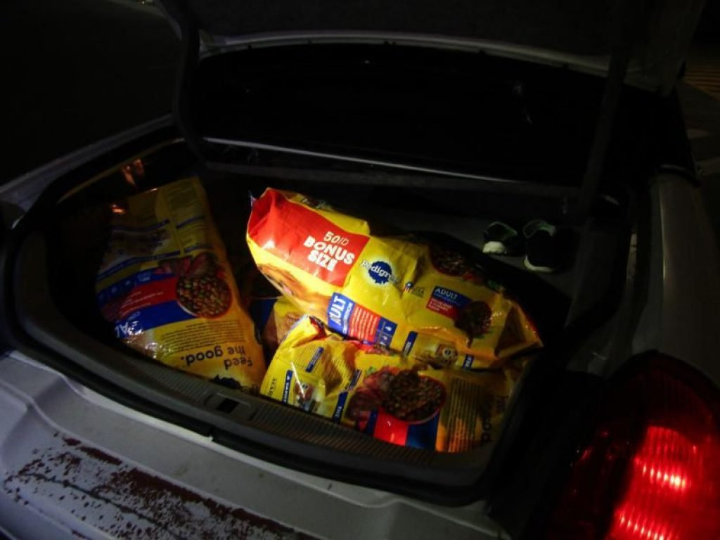 heavy bags of dog food in trunk